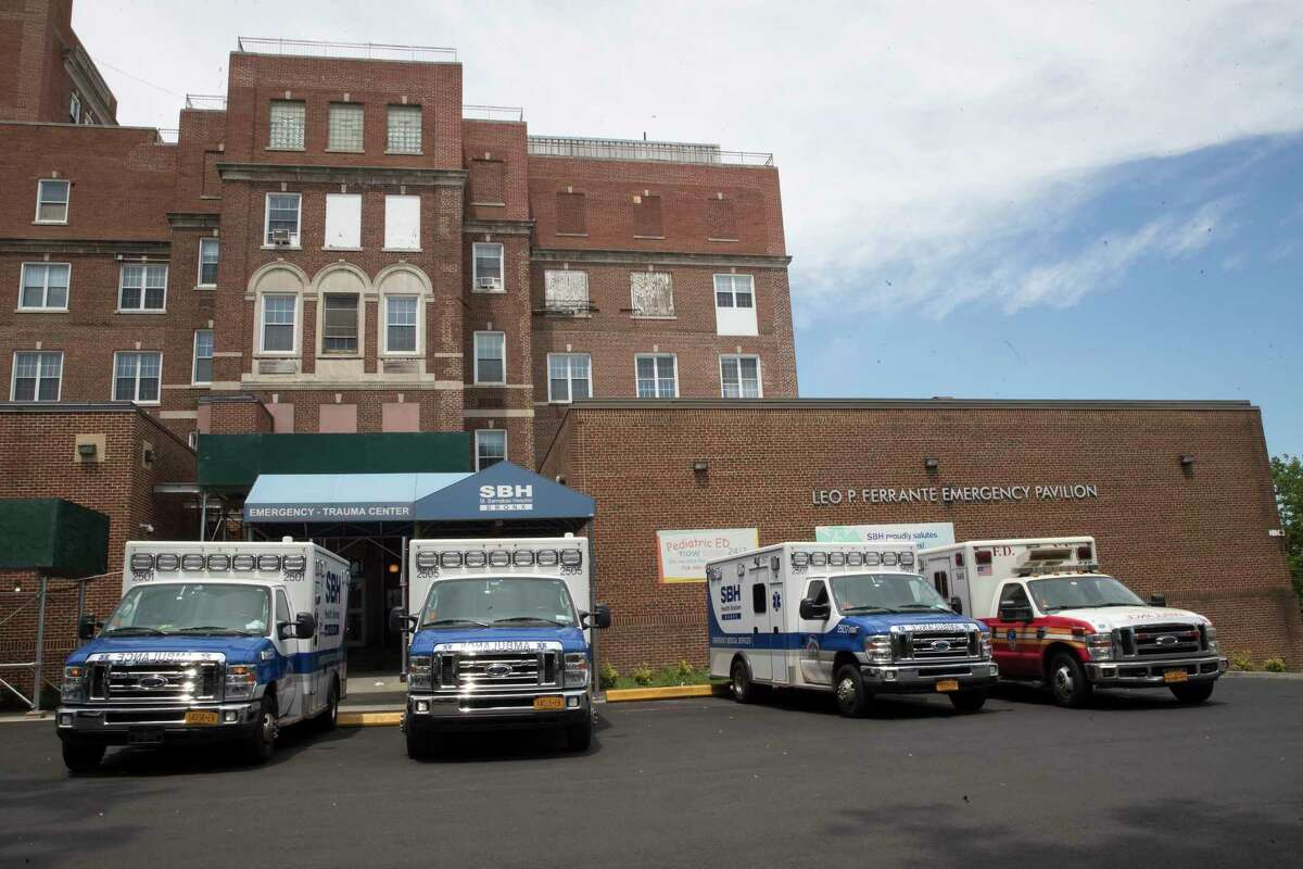Ambulances are seen parked at the entrance to the Emergency Room of St. Barnabas Hospital, Saturday, July 8, 2017, in the Bronx borough of New York. Four days before he ambushed a New York City police officer with a bullet through a window, Alexander Bonds underwent a psychiatric evaluation at St. Barnabas hospital that released him that day. (AP Photo/Mary Altaffer) ORG XMIT: NYMA101