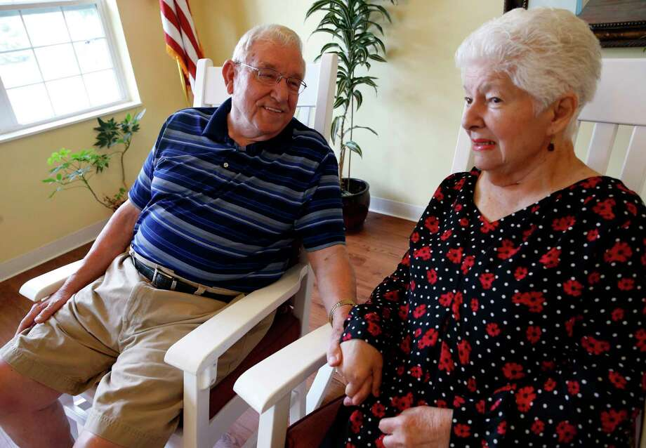 Chuck Schwarz, left, holds hand with his wife Cathy at Heritage Woods of South Elgin, Friday, June 30, 2017, in South Elgin, Ill. Medicaid Americans 65 and order and the disabled make up about a quarter of Medicaid recipients but account for two-thirds of its expenditures. (AP Photo/Nam Y. Huh) ORG XMIT: ILNH103 Photo: Nam Y. Huh / Copyright 2017 The Associated Press. All rights reserved.