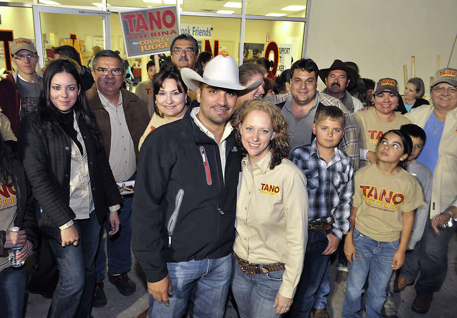 Tano Tijerina, candidate for Webb County Judge, and his wife Kimberly  Jean Walker Tijerina are surrounded by family and friends as they wait for final election results at Tijerina's headquarters. Photo: Cuate Santos/Laredo Morning Times