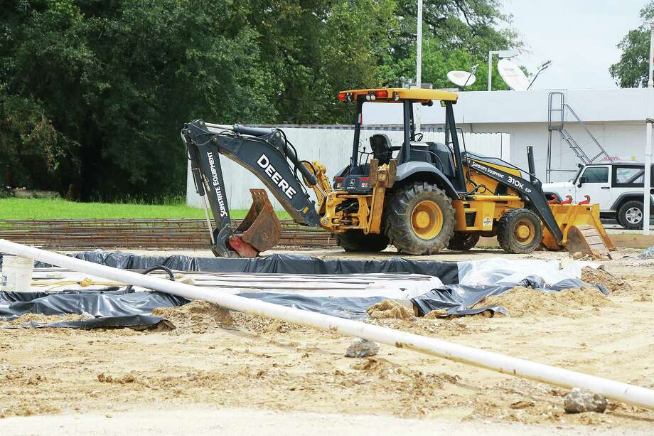 Construction at the new Chicken Express was slowed first by Tropical Storm Cindy and then the pattern of afternoon summer rains. The new chicken eatery has been trying to get the slab poured for the last two weeks. Photo: David Taylor