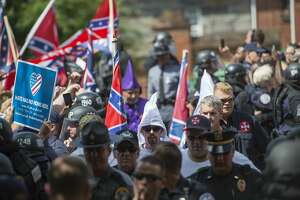 Members of the Ku Klux Klan arrive for a rally, calling for the protection of Southern Confederate monuments, in Charlottesville, Virginia on July 8, 2017. The afternoon rally in this quiet university town has been authorized by officials in Virginia and stirred heated debate in America, where critics say the far right has been energized by Donald Trump's election to the presidency.  / AFP PHOTO / ANDREW CABALLERO-REYNOLDS        (Photo credit should read ANDREW CABALLERO-REYNOLDS/AFP/Getty Images)