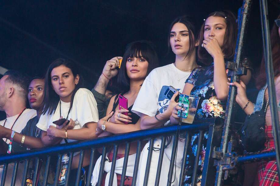 Kylie and kendall jenner bella hadid meet up with travis scott kendall jenner kylie jenner and bella hadid watch travis scotts set side of stage m4hsunfo