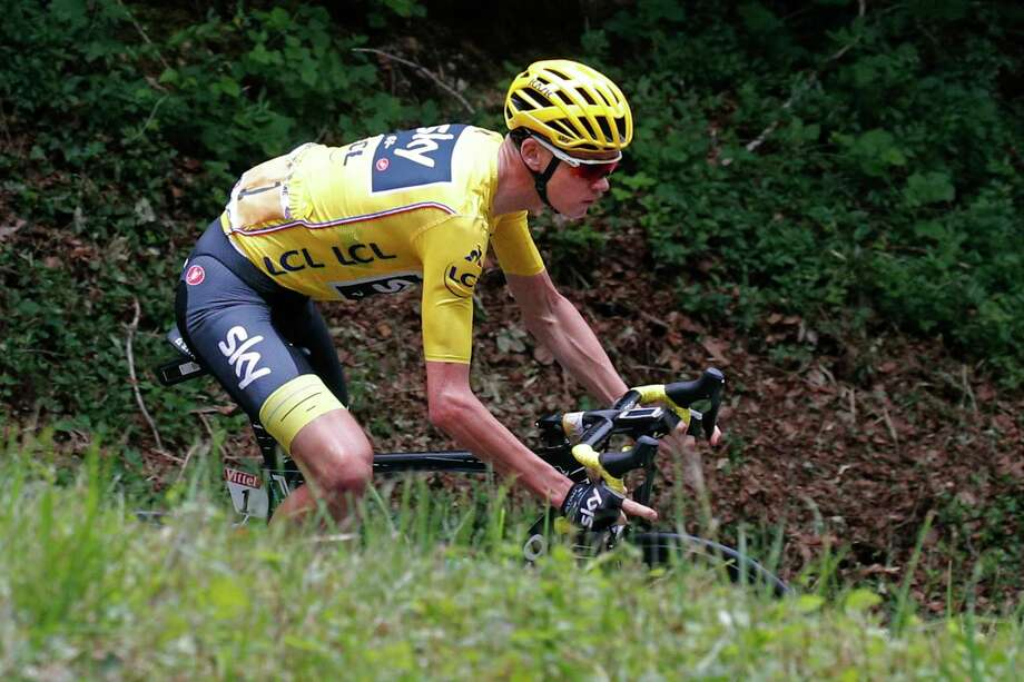 Britain's Chris Froome, wearing the overall leader's yellow jersey, speeds downhill during the ninth stage of the Tour de France cycling race over 181.5 kilometers (112.8 miles) with start in Nantua and finish in Chambery, France, Sunday, July 9, 2017. (AP Photo/Christophe Ena) Photo: Christophe Ena, STF / Copyright 2017 The Associated Press. All rights reserved.