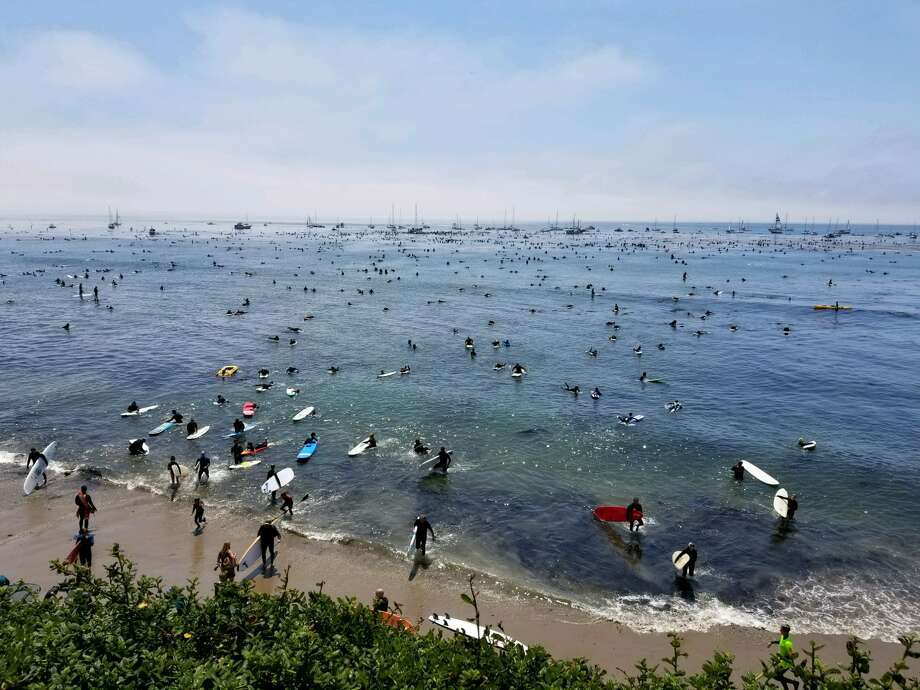Surfers honored wetsuit pioneer Jack O'Neill with a paddleout Sunday at Pleasure Point in Santa Cruz. Photo: Sheila Rad / SFGATE