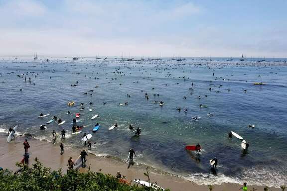 Surfers honored wetsuit pioneer Jack O'Neill with a paddleout Sunday at Pleasure Point in Santa Cruz.