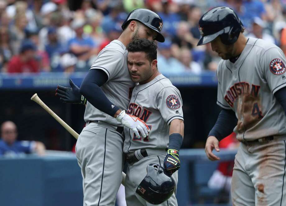 TORONTO, ON - JULY 9: Jose Altuve #27 of the Houston Astros is congratulated by Carlos Correa #1 after hitting a two-run home run in the second inning during MLB game action against the Toronto Blue Jays at Rogers Centre on July 9, 2017 in Toronto, Canada. Photo: Tom Szczerbowski, Getty Images / 2017 Getty Images