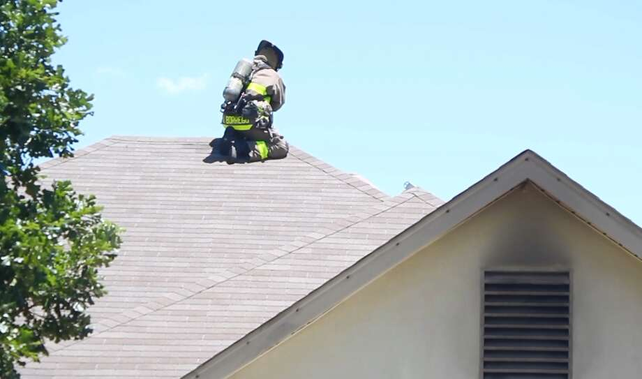 San Antonio Firefighters tackled a house fire on the Northeast Side that was sparked by malfunctioning pool equipment Sunday afternoon July 9, 2017. There were no injuries. Photo: Courtesy JFRO Productions