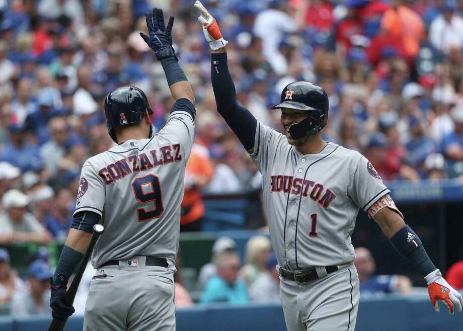 TORONTO, ON - JULY 9: Carlos Correa #1 of the Houston Astros is congratulated by Marwin Gonzalez #9 after hitting a solo home run in the second inning during MLB game action against the Toronto Blue Jays at Rogers Centre on July 9, 2017 in Toronto, Canada. (Photo by Tom Szczerbowski/Getty Images) Photo: Tom Szczerbowski, Stringer / 2017 Getty Images