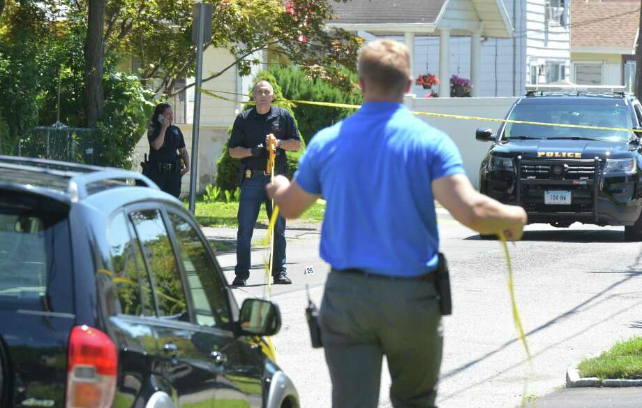 Norwalk police take measurements while investigating a shooting on Plymouth Avenue in Norwalk on Sunday. Photo: Alex Von Kleydorff / Hearst Connecticut Media / Norwalk Hour