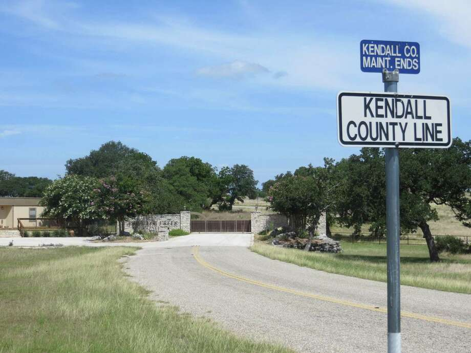 A recent court ruling is a victory for Champee Springs residents in Kendall County, who feared the drive at the end of Turkey Knob Road shown above would become a shortcut between Texas 27 in Kerr County and Interstate 10 north of Boerne in Kendall County. The ruling upheld the legality of a non-access easement that surrounds Privilege Creek Ranches, whose gated entrance is show at the end of this drive, and much of the Champee Springs Ranches subdivision. Photo: Zeke MacCormack / San Antonio Express-News