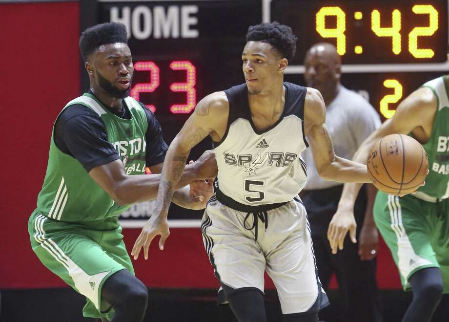 Spurs second-year guard Dejounte Murray (right) was hoping to square off with the No. 1 overall pick of this year's NBA draft, 76ers guard Markelle Fultz, but Fultz missed the matchup Sunday. Photo: Rick Bowmer / Associated Press / Copyright 2017 The Associated Press. All rights reserved.