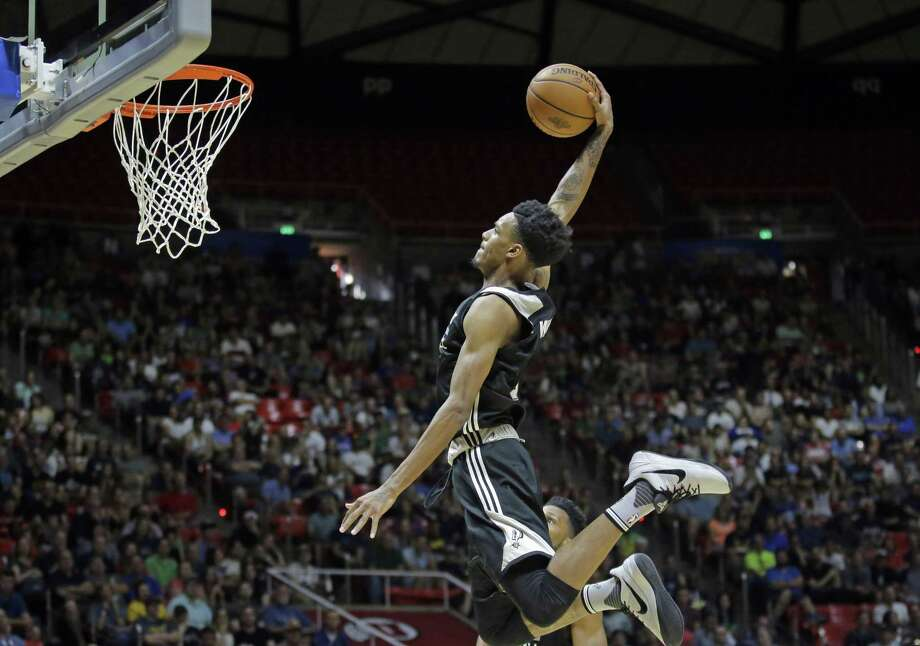 Dejounte Murray (5) dunks the ball against the Utah Jazz during the first half of an NBA summer league game Monday, July 3. Photo: Rick Bowmer / Associated Press / Copyright 2017 The Associated Press. All rights reserved.
