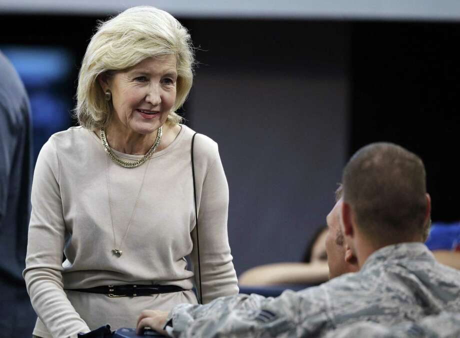 Former U.S. Sen. Kay Bailey Hutchison talks with members of the military before a NFL football game between the Dallas Cowboys and the New York Giants, Sunday, Sept. 8, 2013, in Arlington, Texas. (AP Photo/LM Otero) Photo: LM Otero, STF / AP / AP