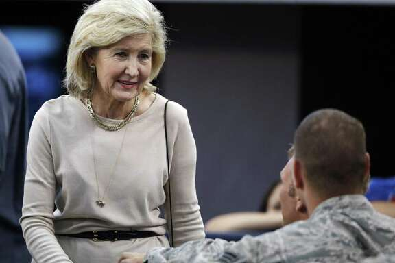 Former U.S. Sen. Kay Bailey Hutchison talks with members of the military before a NFL football game between the Dallas Cowboys and the New York Giants, Sunday, Sept. 8, 2013, in Arlington, Texas. (AP Photo/LM Otero)