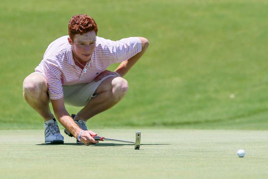 Ian Berrigan lines up a putt on the ninth hole during the second day of the San Antonio Men's Championship at the Quarry Golf Club on Saturday, July 8, 2017.  Berrigan, a senior at McNeese State and an O'Connor High School graduate, birdied the hole and shot a course record nine-under-par 62 on the day.  MARVIN PFEIFFER/ mpfeiffer@express-news.net Photo: Marvin Pfeiffer, Staff / San Antonio Express-News / Express-News 2017