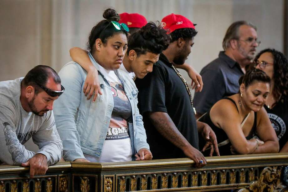 Mercedes Lefiti (second from left) and brother Malachi Lefiti (center), 16, embrace before the City Hall memorial service for their father, Michael Lefiti, and Wayne Chan and Benson Louie, who were killed in a June shooting at the UPS facility on San Francisco's Potrero Hill. Photo: Gabrielle Lurie, The Chronicle