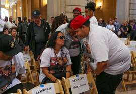 The Lefiti family gathers ahead of a memorial service at City Hall for Michael Lefiti and the two other victims who were killed in a shooting at a UPS facility in Potrero Hill last month in San Francisco, California, on Sunday, July 9, 2017.