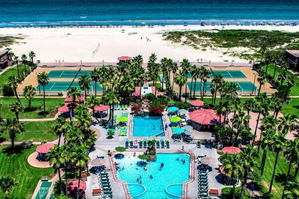 Isla Grand Beach Resort   500 Padre Blvd.  South Padre Island  Room rates vary on weekends during the summer.  Pool and garden suites generally start about $300.  There are 12 suites facing the beach that start about $320.  The tower condos run from $499 - $599.