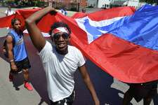 The 24th Annual Puerto Rican Parade of Fairfield County on Sunday July 9, 2017 in Bridgeport Conn.Thousands lined the parade route down Park Ave. while floats, dancers, clubs, politicians and civic organizations made their way to Seaside Park where the festivities continued. The theme of this year's parade was 'Power and Pride in Our Voices'