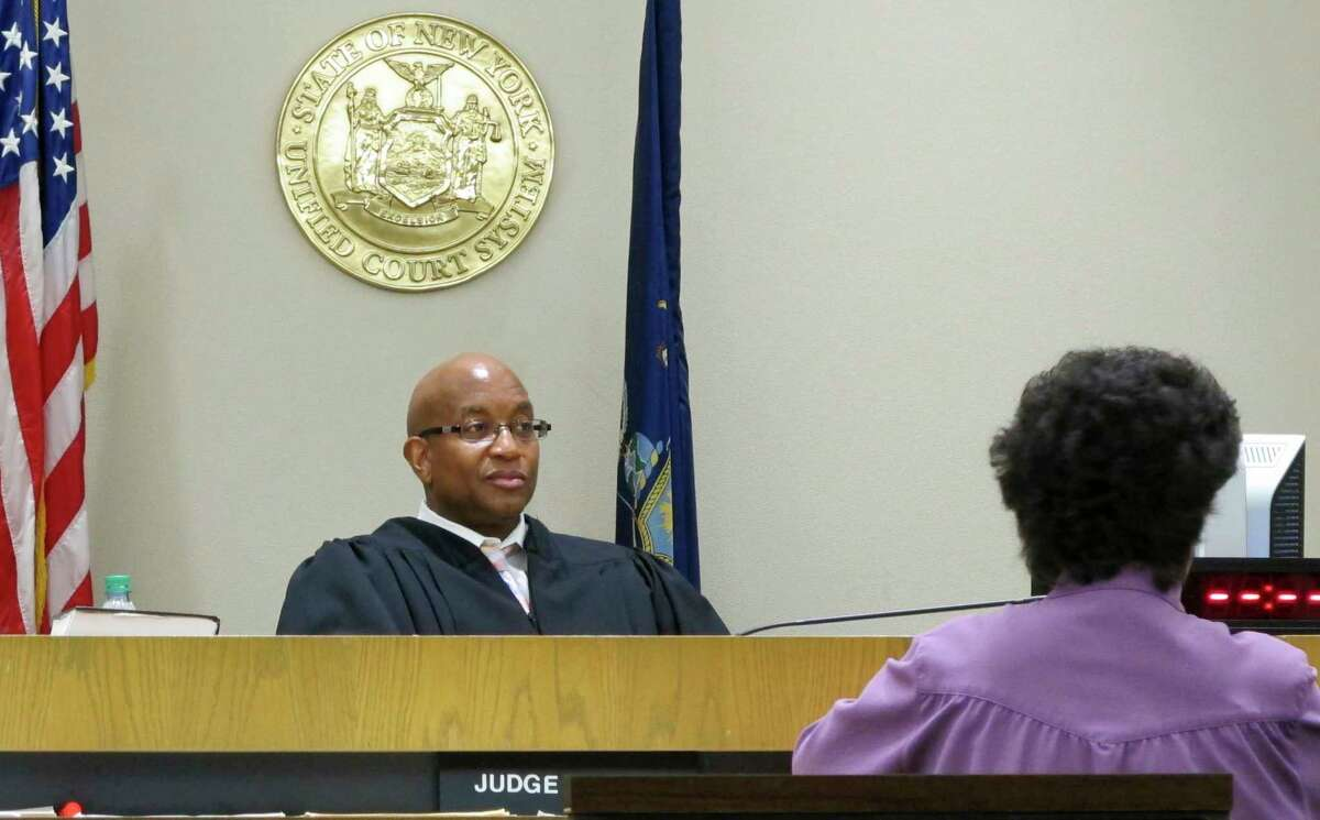 In this June 20, 2017 photo, City Court Judge Craig Hannah presides at Opiate Crisis Intervention Court in Buffalo, N.Y. The first such program in the country puts users under faster, stricter supervision than ordinary drug courts, all with the goal of keeping them alive. (AP Photo/Carolyn Thompson) ORG XMIT: NYR401