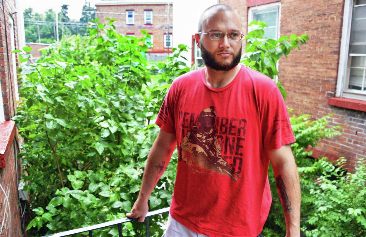 US Army Iraq veteran Dustin Greco outside his home Friday June 30, 2017 in Cohoes, NY. (John Carl D'Annibale / Times Union)