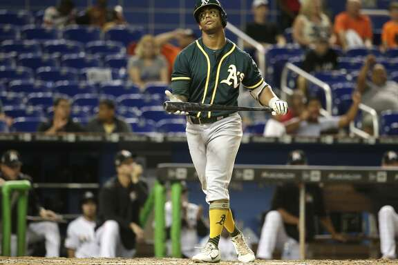 Oakland Athletics' Khris Davis strikes out during the ninth inning of an interleague baseball game against the Miami Marlins, Tuesday, June 13, 2017, in Miami. The Marlins won 8-1. (AP Photo/Lynne Sladky)