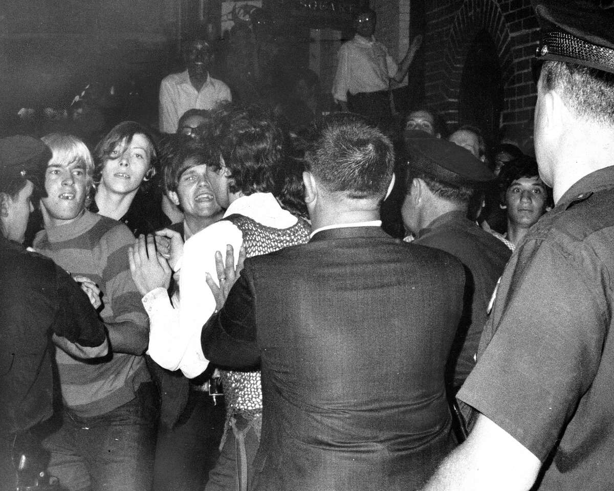 """""""Our histories are more than a month,"""" said HISD superintendent Richard Carranza. In this photo: A crowd tries to impede the police raid at the Stonewall Inn in New York City."""