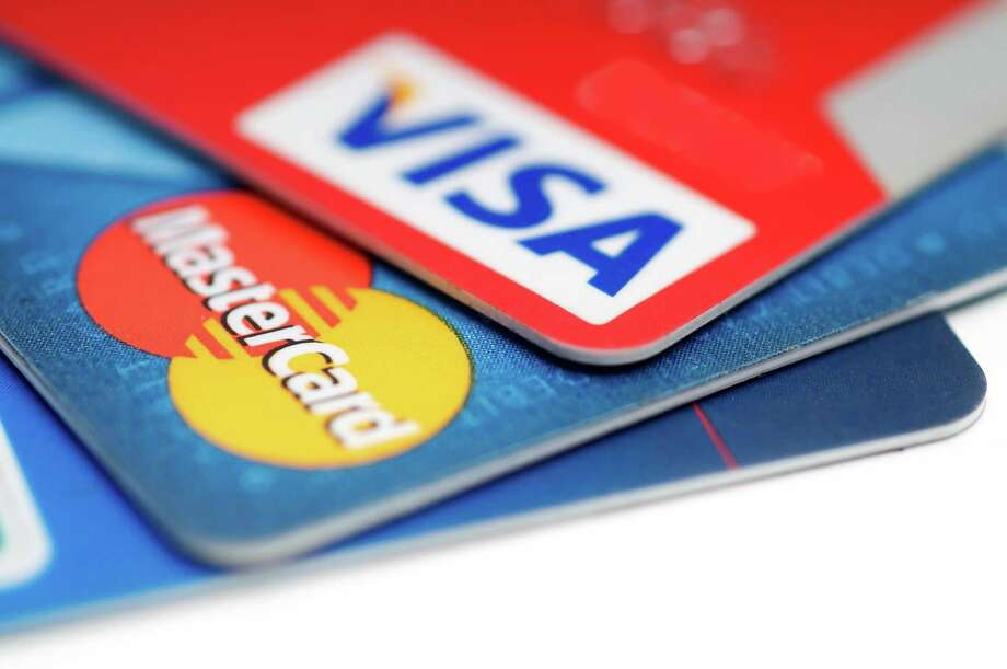 The Connecticut Better Business Bureau recommends consumers take into account potential risks when an online retailer offers to keep your credit card information on file. Photo: Dreamstime / TNS / TNS