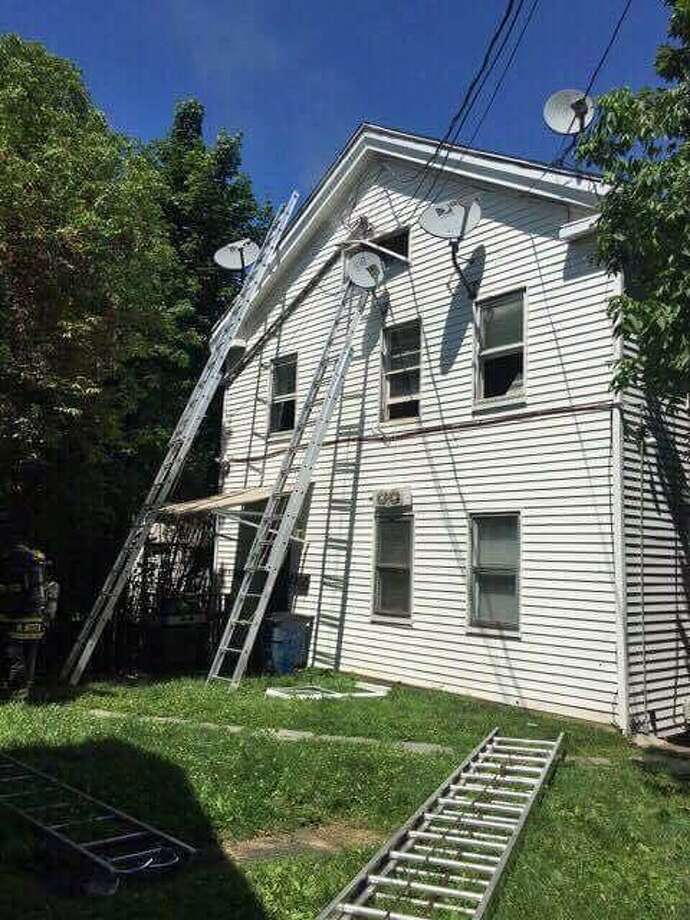 A Derby, Conn. firefighter was treated for heat exhaustion after fighting a fire at this home on Sunday, July 9, 2017 Photo: Contributed Photo / Derby Fire Dept. / Contributed Photo / Connecticut Post