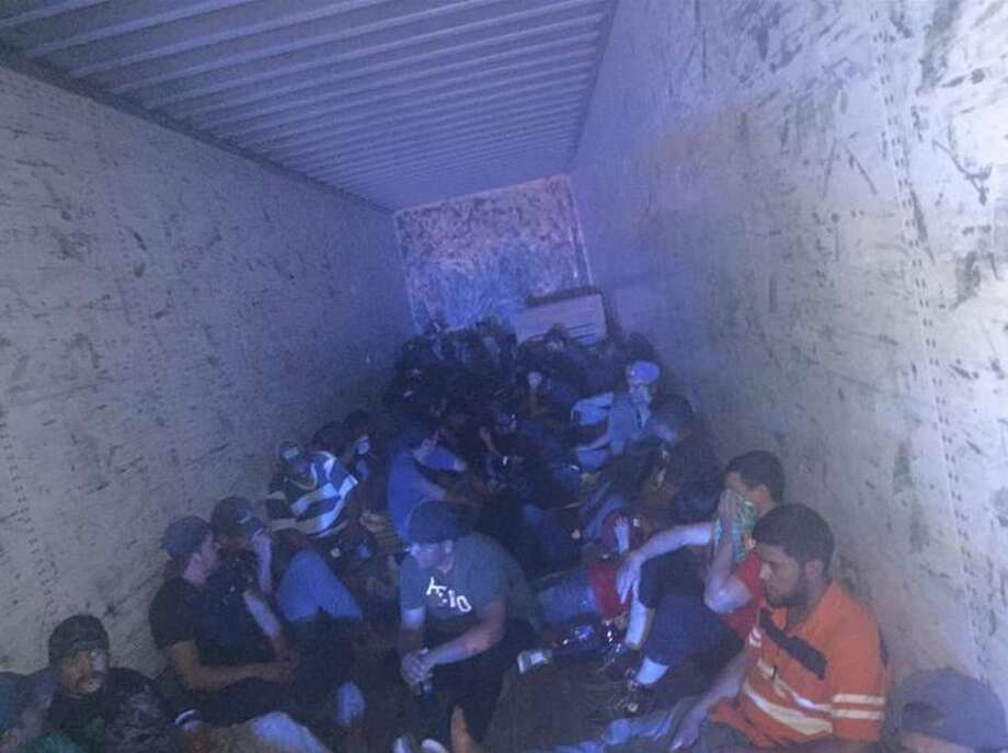 BP agents encountered a white tractor-trailer near Tejas Loop on Friday. After inspecting the vehicle, agents discovered 72 people concealed inside.   Photo: Courtesy