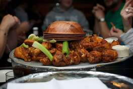 A large order of wings, Anchor Bar's specialty. The bar food staple was invented at the original Anchor Bar in Buffalo, New York.