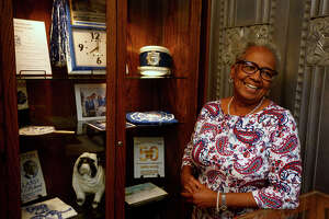 Bettye Duplantier, president of the Charlton-Pollard High School Alumni Association, laughs while sharing memories of her time at the school in the mini museum at the Jefferson County Courthouse on Friday. Duplantier was part of the school's 1963 class.  Photo taken Friday 7/7/17 Ryan Pelham/The Enterprise