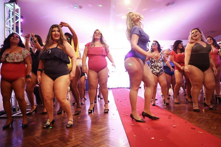 Contestants compete during the Miss Plus Size Carioca beauty pageant on July 8, 2017 in Rio de Janeiro, Brazil. 24 contestants, aged 18-45, competed in the contest which aims to challenge modern inclusive standards of beauty. Continue clicking to see the other scenes from the beauty pageant. Photo: Mario Tama/Getty Images