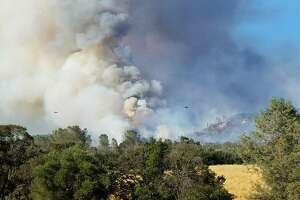 Smoke rises over the Wall Fire in Butte County.