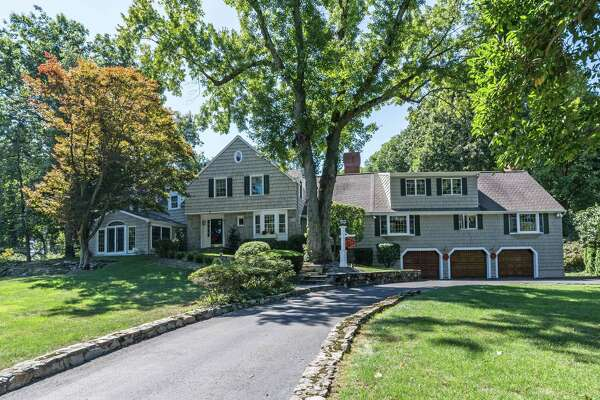 The classic colonial house at 165 White Oak Road sits on a property of three quarters of an acre within sight of the Brooklawn Country Club and golf course.