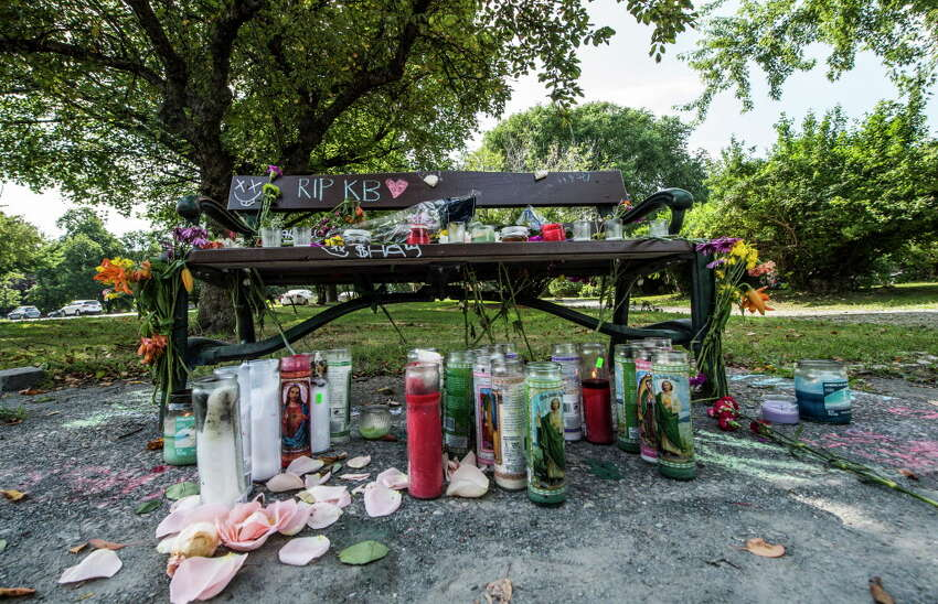 A makeshift memorial for a woman found unresponsive over the weekend sits on and around a park bench in Washington Park Monday July 10, 2017 in Albany, N.Y. (Skip Dickstein/Times Union)