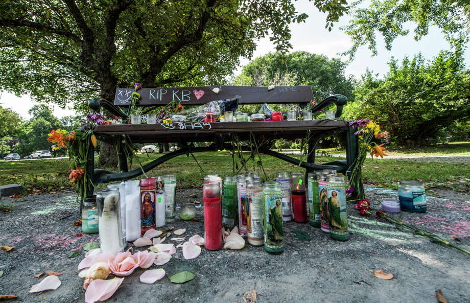 A makeshift memorial for a woman found unresponsive over the weekend sits on and around a park bench in Washington Park  Monday July 10, 2017 in Albany, N.Y.  (Skip Dickstein/Times Union) Photo: SKIP DICKSTEIN, Albany Times Union / 40041003A