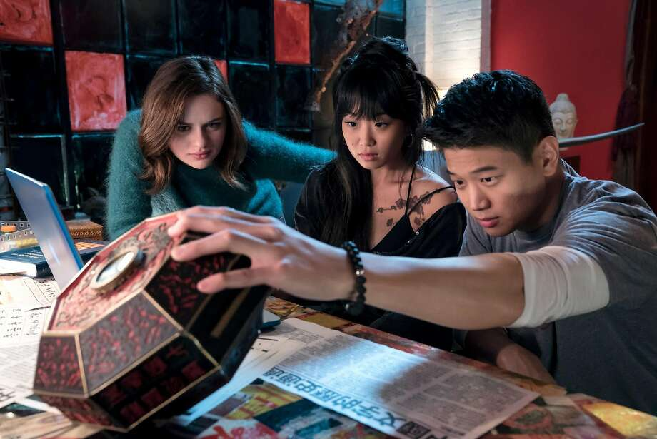 """Joey King (left) stars as Clare, who finds a box that grants wishes but extracts a hefty price. She shows it to friends Gina (Alice Lee) and Ryan (Ki Hong Lee) in the horror movie """"Wish Upon."""" Photo: Steve Wilkie/Broad Green Picture, TNS"""
