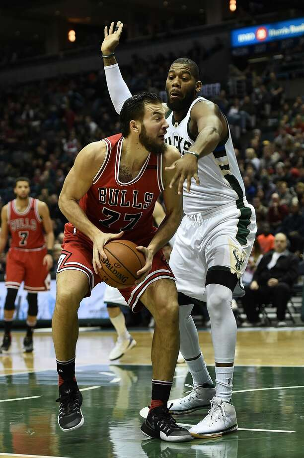 MILWAUKEE, WI - MARCH 26:  Joffrey Lauvergne #77 of the Chicago Bulls is defended by Greg Monroe #15 of the Milwaukee Bucks during the first half of a game at the BMO Harris Bradley Center on March 26, 2017 in Milwaukee, Wisconsin. NOTE TO USER: User expressly acknowledges and agrees that, by downloading and or using this photograph, User is consenting to the terms and conditions of the Getty Images License Agreement.  (Photo by Stacy Revere/Getty Images) Photo: Stacy Revere/Getty Images