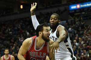 MILWAUKEE, WI - MARCH 26:  Joffrey Lauvergne #77 of the Chicago Bulls is defended by Greg Monroe #15 of the Milwaukee Bucks during the first half of a game at the BMO Harris Bradley Center on March 26, 2017 in Milwaukee, Wisconsin. NOTE TO USER: User expressly acknowledges and agrees that, by downloading and or using this photograph, User is consenting to the terms and conditions of the Getty Images License Agreement.  (Photo by Stacy Revere/Getty Images)
