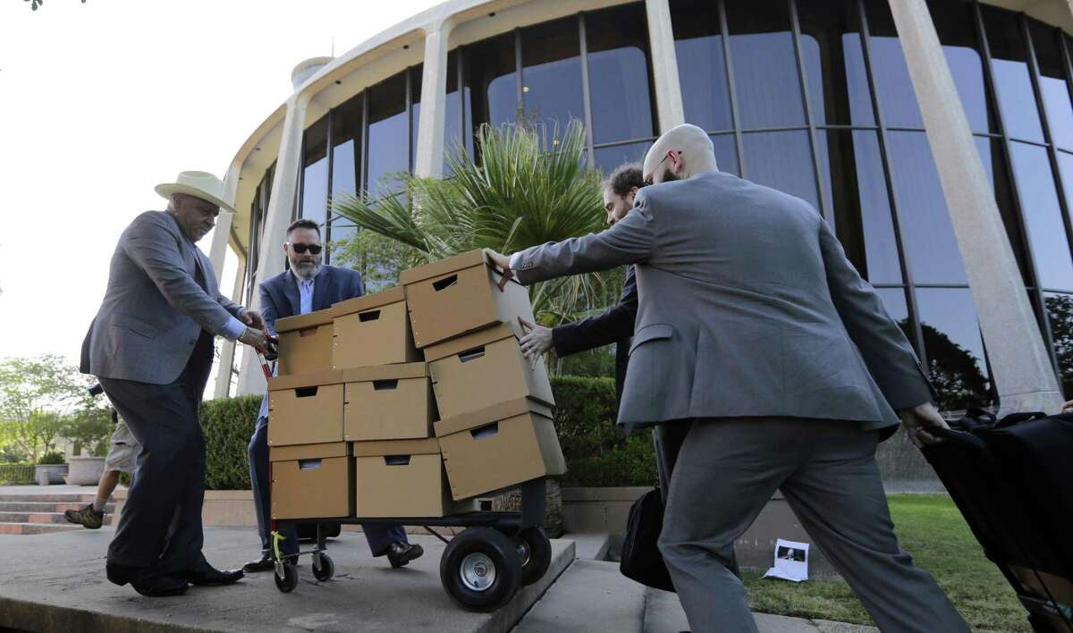 A group moves boxes into the federal courthouse on July 10, 2017, in San Antonio, where a redistricting trial was set to begin.