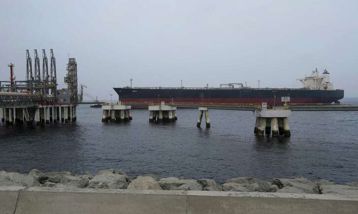 File photo of an oil tanker approaching a new Jetty during the launch of a $650 million oil facility in Fujairah, United Arab Emirates. The Abu Dhabi National Oil Co., or ADNOC, the United Arab Emirates' main state oil company, is seeking to create joint ventures with international investors and is considering floating shares in some of its businesses in an effort to raise billions of dollars according to plans disclosed Monday, July 10, 2017, in an article in the Abu Dhabi-based state-linked daily The National.