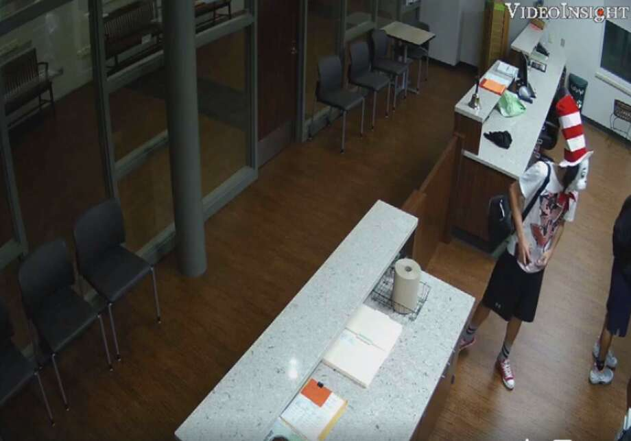 """La Porte Police are asking the public's health in identifying three suspects, one of which was wearing a """"Cat in the Hat"""" mask, seen robbing a local middle school.Click through to see other Houston fugitives police are looking for."""