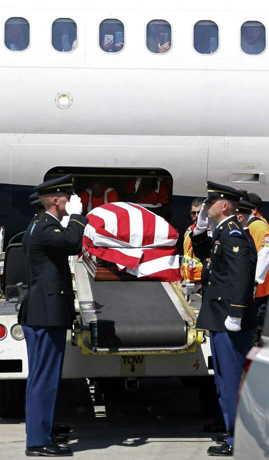 The remains of Cpl. Frank Luna Sandoval arrive at the San Antonio International Airport, Monday, July 10, 2017. Sandoval was missing action and presumed dead since the Korean War. Sandoval was 20-years-old when he was take as a prisoner of war and died of malnutrition. His family was on the tarmac to receive the remains. Photo: JERRY LARA / San Antonio Express-News / San Antonio Express-News