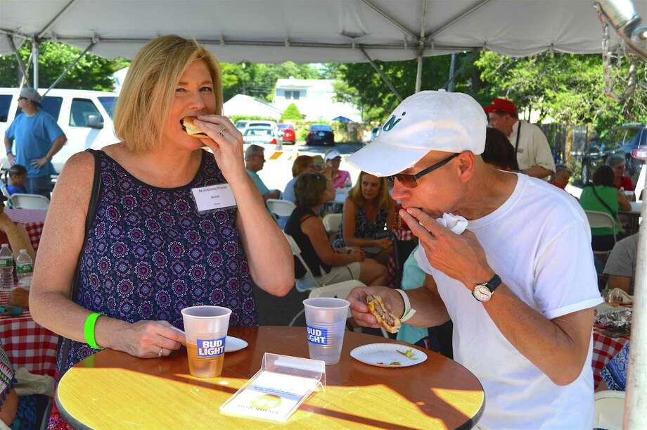 Ann and Tom Andrukevich of Fairfield enjoy a bite at the St. Anthony of Padua Parish's annual Parish Picnic, Sunday, July 9, 2017, in Fairfield, Conn. Photo: Jarret Liotta / For Hearst Connecticut Media / Fairfield Citizen News Freelance