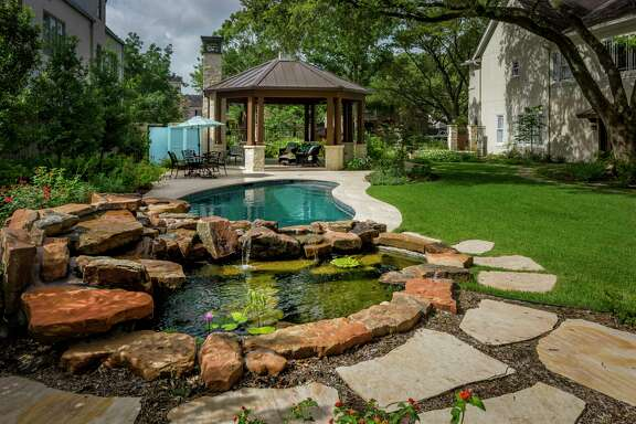 A lily pond provides a home for toads and goldfish at the West University home of Marilyn Wolfe-Kirk and Harry Kirk.