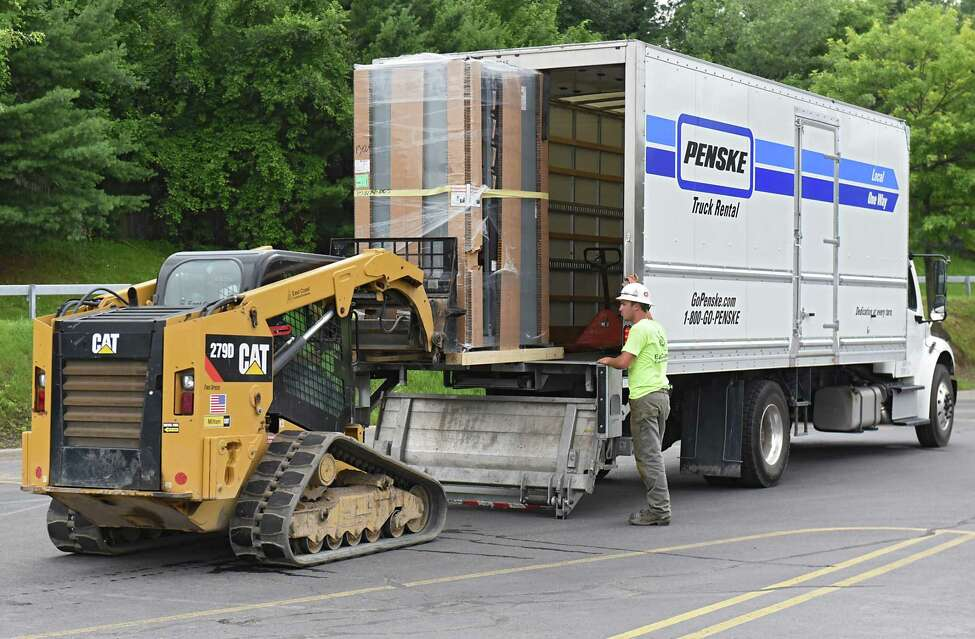 Equipment for Tesla supercharging stations is unloaded from a truck at Crossgates Mall on Monday, July 10, 2017 in Guilderland, N.Y. The Silicon Valley electric car maker is currently constructing a 20-car supercharging station at the Mall. The charging station will be located at the far end of the parking lot in front of Dave & Busters near Dick's Sporting Goods. (Lori Van Buren / Times Union)