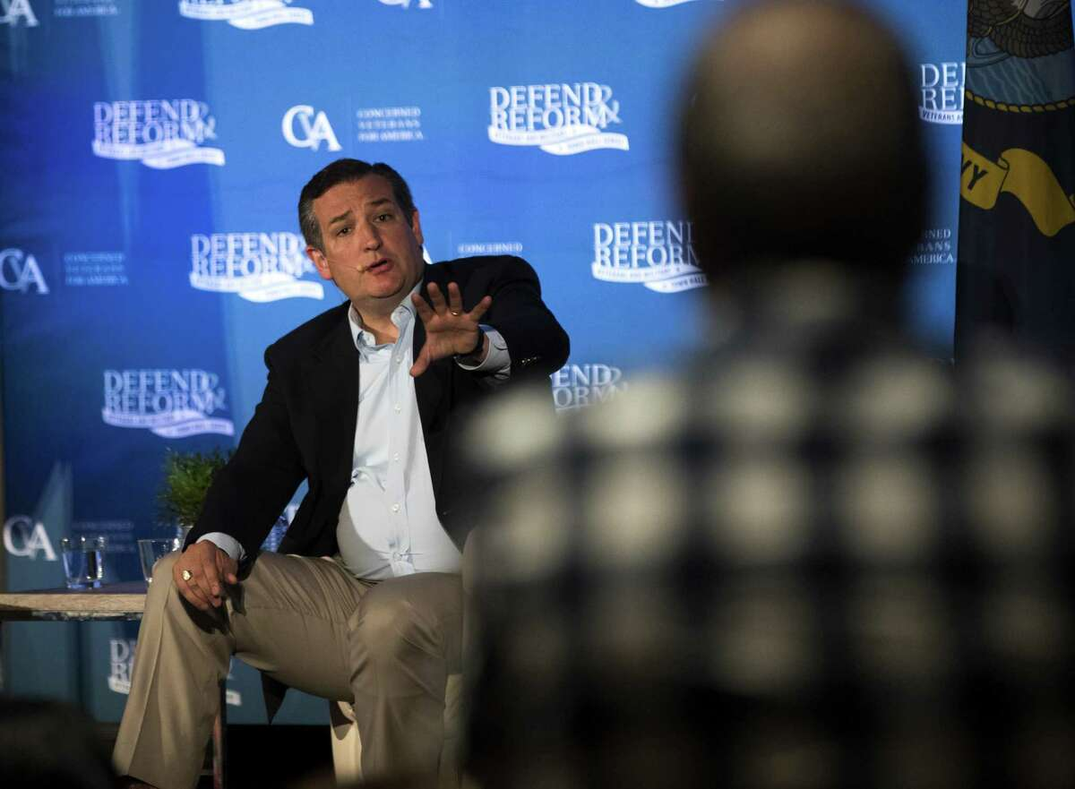 Texas Sen. Ted Cruz discusses health care issues with a concerned citizen during a town hall meeting in Austin recently. He has proposed the Consumer Freedom Option, which allows insurers to sell plans that don't comply with Obamacare regulations (such as protections for preexisting conditions), so long as they also sell at least one plan that does.