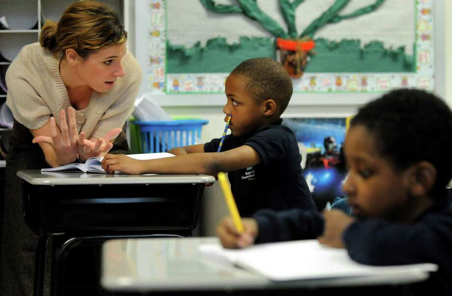 Some charter school operators are pushing of using a different method of certifying their teachers. That needs to be examined carefully. Here, teacher Nicole Rich, left, helps first-grader Rahcir Goggin 6, with a writing exercise in 2009, at Brighter Choice Charter School for Boys in Albany. (Cindy Schultz / Times Union) Photo: CINDY SCHULTZ / 00006122A