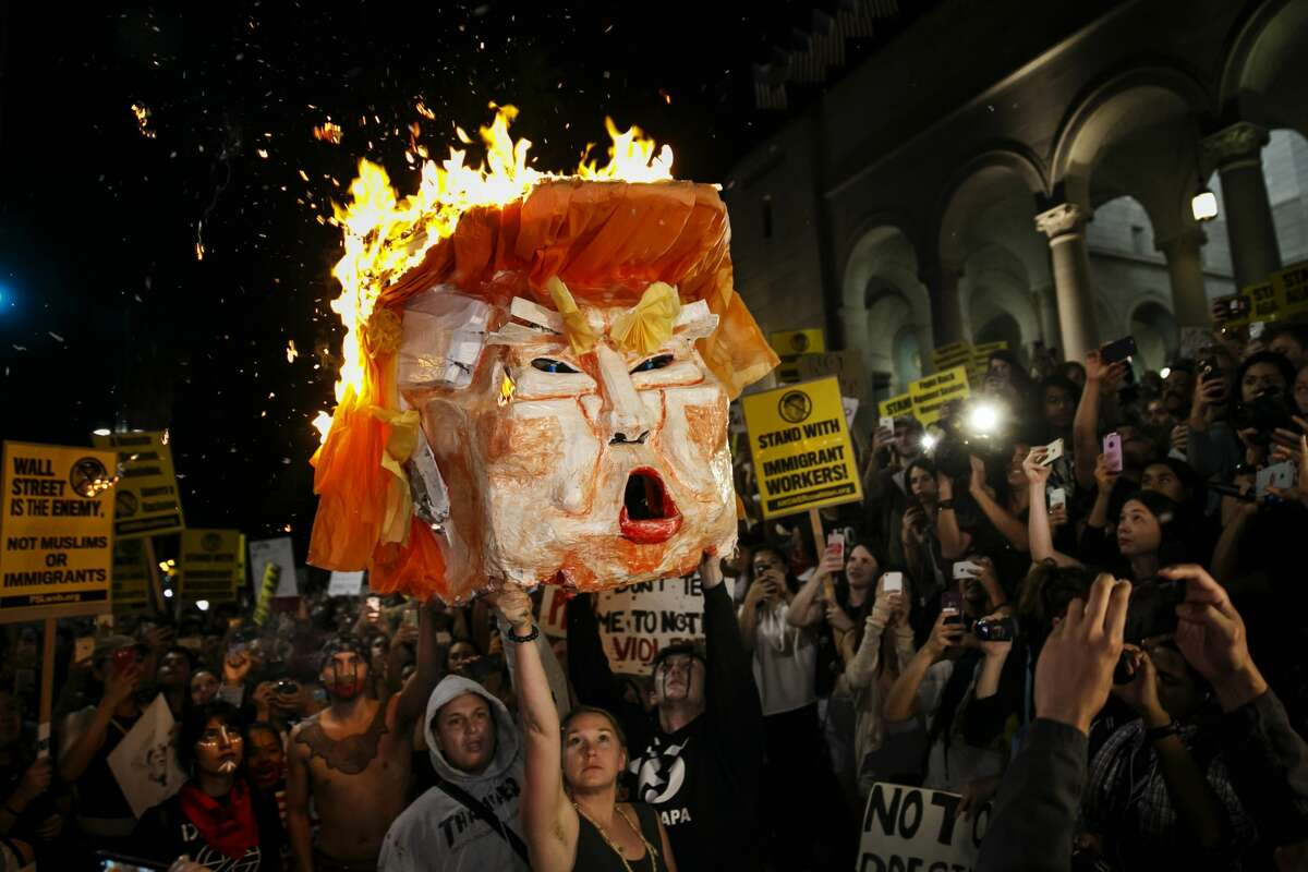 Politicians at both state and city levels have publicly called for the removal of Donald Trump from office - among them Lt. Governor Gavin Newsom, according to the Bay Area News Group. Los Angeles-area Rep. Brad Sherman is championing the latest longshot impeachment attempt. Governor Jerry Brown, a staunch opponent of Trump's proposed Mexico border wall, has sardonically proposed building his own wall around California.  Photo: Anti-Trump protesters burn an effigy of the president-elect, Donald Trump, outside City Hall in Los Angeles, Calif., on Nov. 9, 2016.